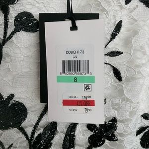 Dkny Dresses - White dress with black and white lace detail.